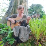 Kate Doubleday with guitar photographed by Eva Bartussek
